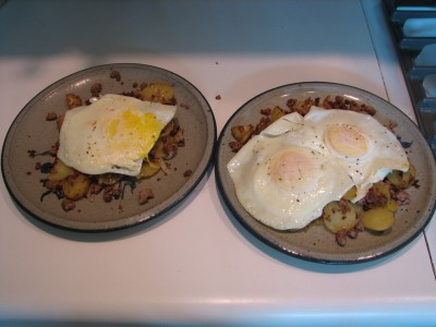 Ground pork hash with potatoes and onions, topped with fried eggs