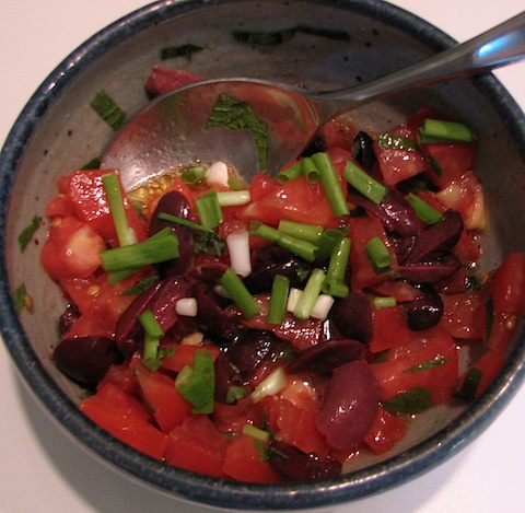 Chopped tomatoes, mint, oregano, kalamata olives, and green onion