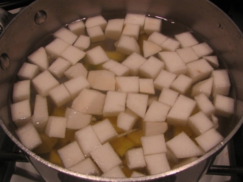 Boiling diced turnips and potatoes
